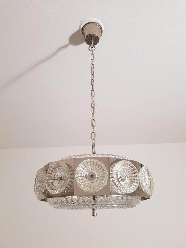 Vintage ceiling lamp in chromed metal and glass from Orrefors in Sweden. Produced in the 1960s by Swedish Orrefors. Scandinavian Modern design with the traditional metal and glass combination. Swedish Carl Fagerlund is famous for his cooperation