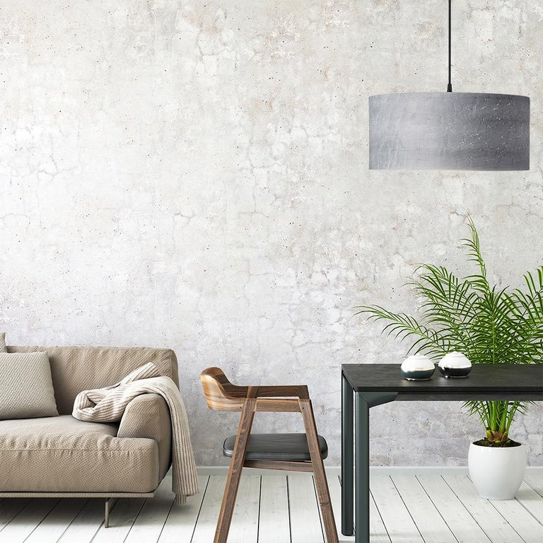 This large Grey Bird's-eye Maple wood drum light, CANNEA is a Mid-Century Modern style pendant. As a chandelier for alcove, entryway, dining room or conference room, CANNEA is offered in several custom wood types. CANNEA gives a warm light,
