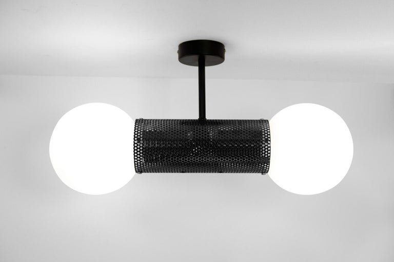 Australian Perf Double Pendant Light, Brass Perforated Tube, Glass Round Orb Shades For Sale