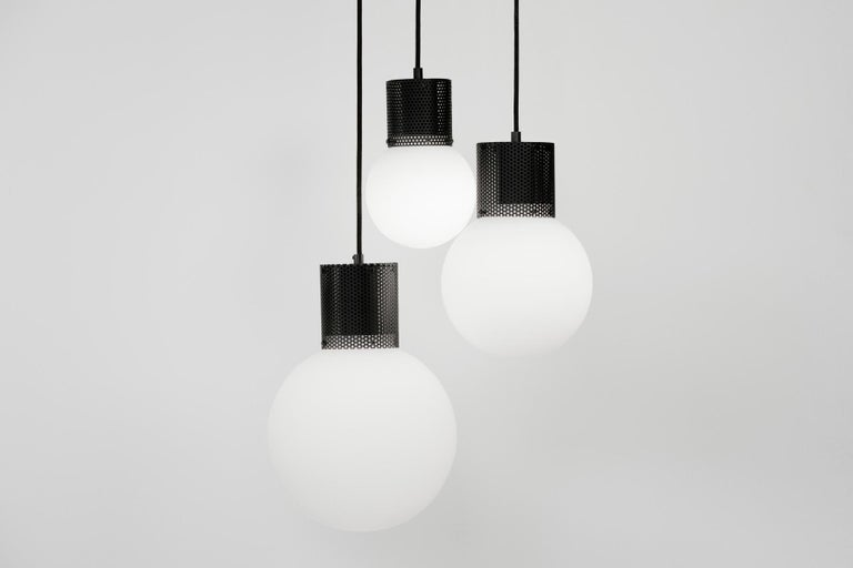 Combining hand blown opal glass with a perforated metal housing, Perf Pendant is an elemental and versatile decorative fixture. Utilizing a low energy LED bulb, Perf Pendant is available in 3 sizes and 3 finishes, with custom colors available.