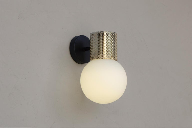 Contemporary Perf Wall Sconce, Off-White Perforated Tube, Glass Round Orb Shade For Sale