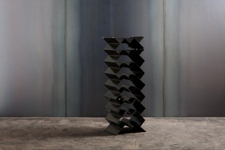 Fold wine rack is a brutalist inspired modular design that can be stacked in a variety of sizes and configurations. Made from folded sheet metal with an iridescent zinc plated finish. The intention of the Fold collection is to express the purity of