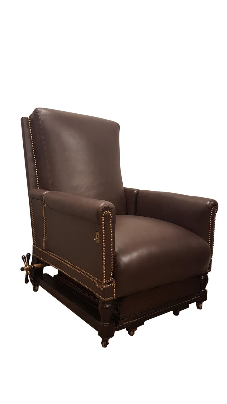 This is a large grand 19th century fully adjustable armchair that has been fully reupholstered in Connolly leather. Connolly leather supply amongst others Aston Martin. The back on the chair reclines with the use of a very unique winding mechanism