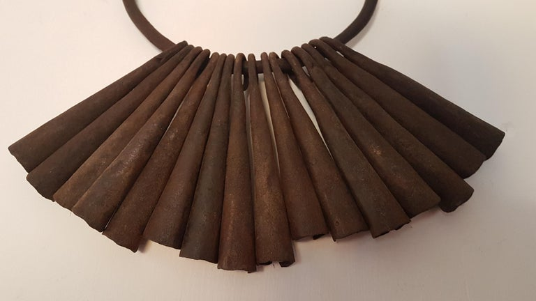 An excellent and unusual early 20th century tribal currency item that has 16 individual gongs on a large iron hoop. Displays well and can be hung anywhere, measures 30cm high from top to bottom, average gong height is 13cm with the hoop diameter