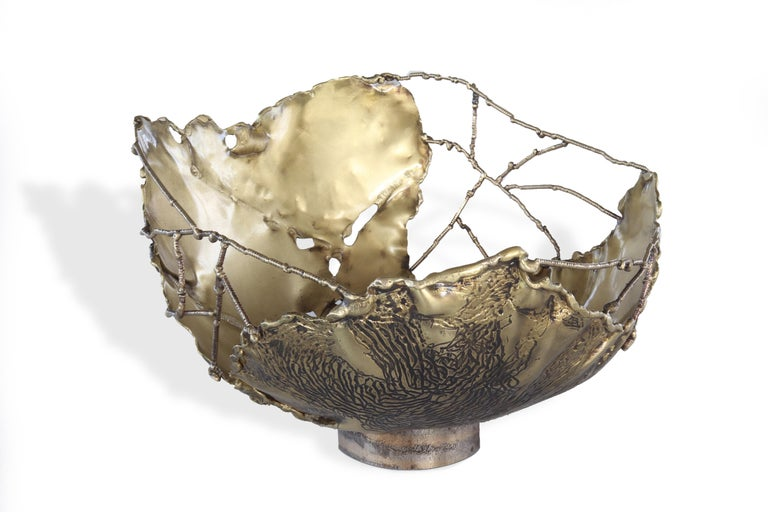 Cylindrical modern bowl in hammered Brass molded with fire. Spider webs in welded brass wire. External surface carved with burnished and polished veins. Entirely handmade in Italy signed and numbered.  The power of fire, the connections between