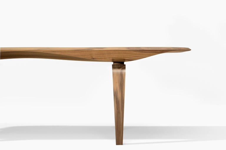 Named a 2018 Best of Year Awards Honoree by Interior Design Magazine. KG bench merges mannerism with engineering. Carved out of the finest solid Noce Canaletto (Black Walnut) the sinuous arched profile goes from mysteriously thin to substantial, in
