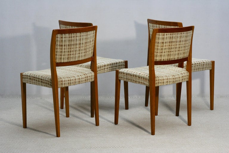 This set is in a fully original condition, features a beige boucle fabric upholstery and a solid teak wood frame. The chairs are heavy and stable, its' size is bigger than normal chair size.