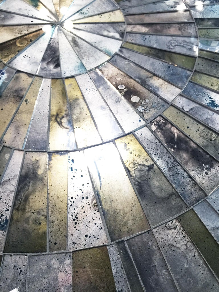 Silver Dust (églomisé) mirror mosaic coffee table designed by Ercole Home with handcut mirror mosaic surface in Sunburst pattern. The base is made of 1/2''thick tubular metal in Natural Steel finish. Custom sizes and finishes are available. You