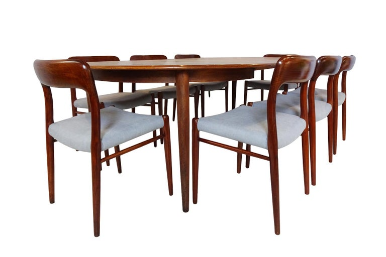 A superb midcentury Danish teak extending dining table and 8 x Model 75 chair dining set designed by Niels Otto Møller.  Originally designed in the 1950s, this set was produced in the 1960s and owned from new by the same family. The set is in