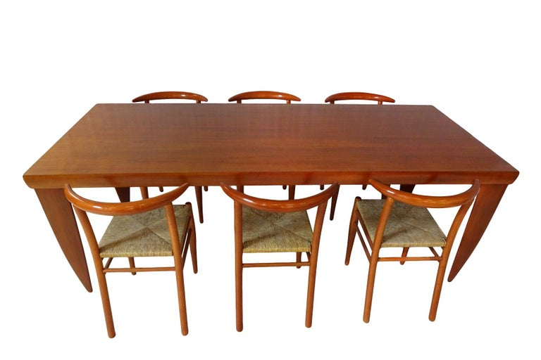 An impressive and substantial dining set incorporating a large solid cherrywood dining table matched with 6 Philippe Starck cherrywood Tessa nature chairs.  Although they are by separate design teams this dining set is an excellent match. Both in