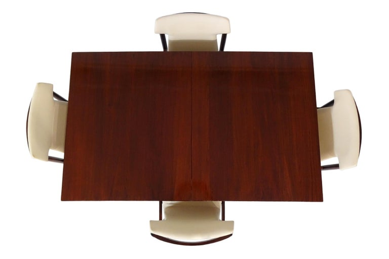 Danish midcentury dining table and chairs set by Inger Klingenberg.  Danish designer Inger Klingenberg (1932-1997) in my opinion produced some of the most compelling furniture designs of the period and was a key designer in helping to establish