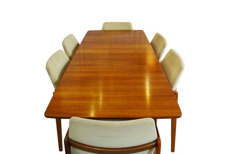 Danish Midcentury space saving dining set featuring a set of 6 Kai Kristiansen chairs matched to a Nils Jonsson extending table.  This is a perfect choice if you're looking for Danish Mid century dining set with a relatively small foot print to