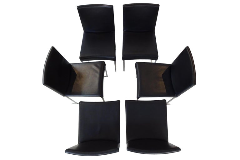 An exceptional set of 6 pre-owned and cherished black leather B&B Italia dining chairs: RRP £7,000  Six black leather B&B Italia Maxalto Solo dining chairs designed by Antonio Citterio – presented in very good condition and at a fraction of the