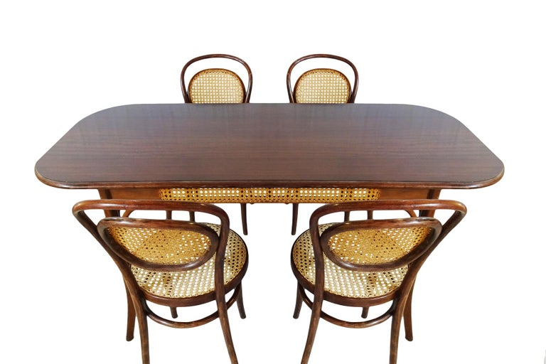 An excellent antique dining set comprising 4 x Michael Thonet designed No. 11 bergère chairs with a matching bergère sided table, circa 1910-1914  It's very rare to find 4 matching antique Thonet designed chairs with the bergère backs alongside a