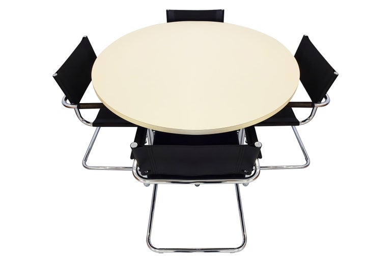 Bauhaus dining set featuring 4 Mart Stam cantilever chairs in black leather and chrome and an original Thonet cream melamine topped and chrome table – circa 1960s.  This is an excellent modernist dining set that has a sophisticated appeal created by