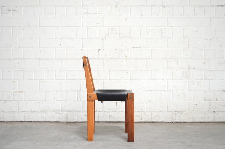 A vintage S 24 Pierre Chapo dining or office chair. Made of elmwood and black saddle leather. This chair is an old version and comes of the 1970s.