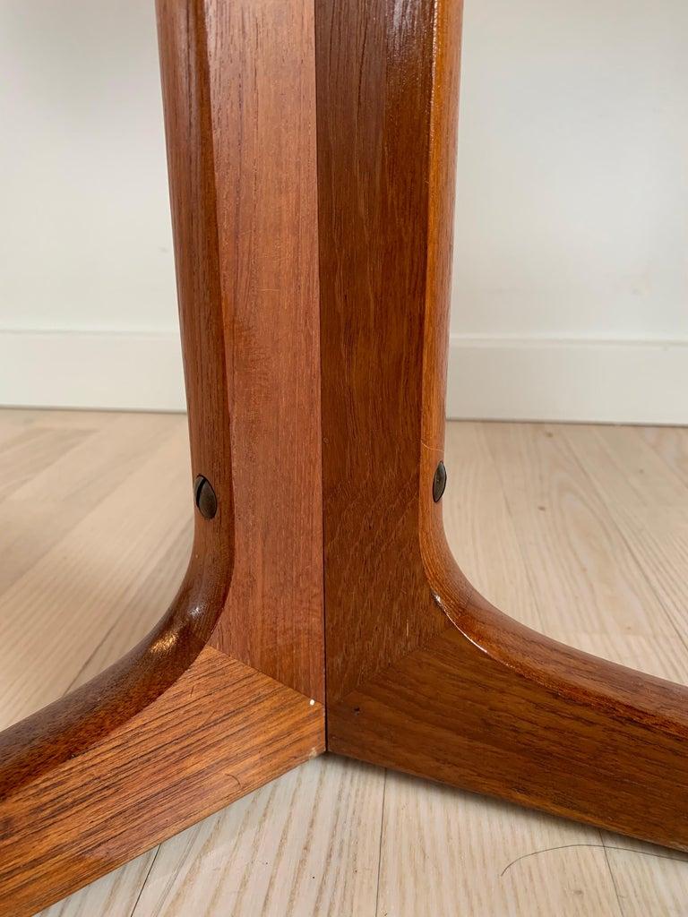 Hans C Andersen Danish design turn teak table on a tripod base, 1950s. Marked underneath.