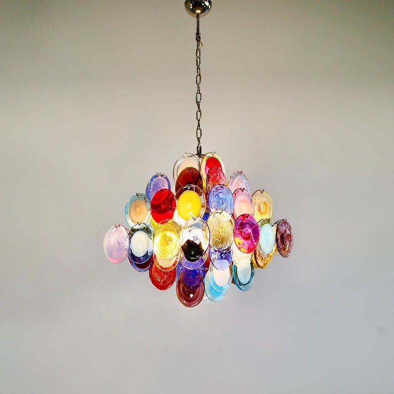 Large glass disk chandelier. Italy, Murano.  Chandelier with multicolored glass disks, hand blown in Murano. Metal frame with ten light sockets.