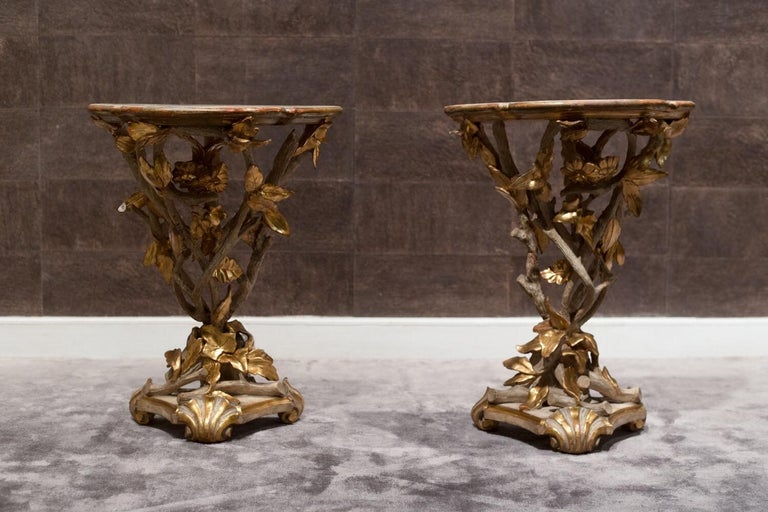 Pair of gueridons in gilded, lacquered wood.