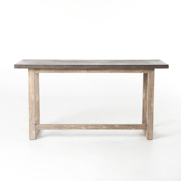 "A Minimalist style desk with concrete top. The wooden base with white washed finish. Dimensions: W 59"", H 29.75"", D 24""."