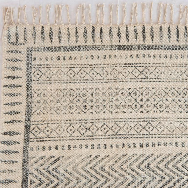 We have a collection of these tribal style flat-weave cotton faded color dhuri floor rugs in various sizes, contact us for current stock.