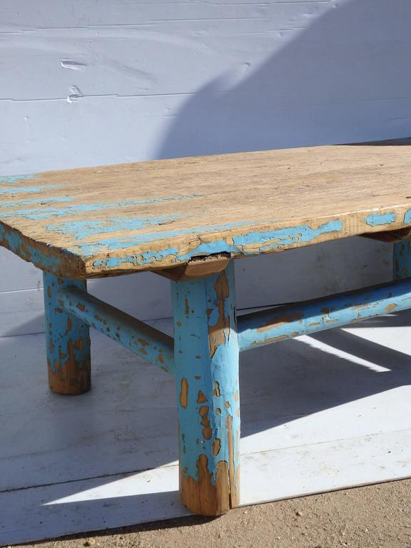 Primitive Chinese coffee table with remains of original bright blue paint.