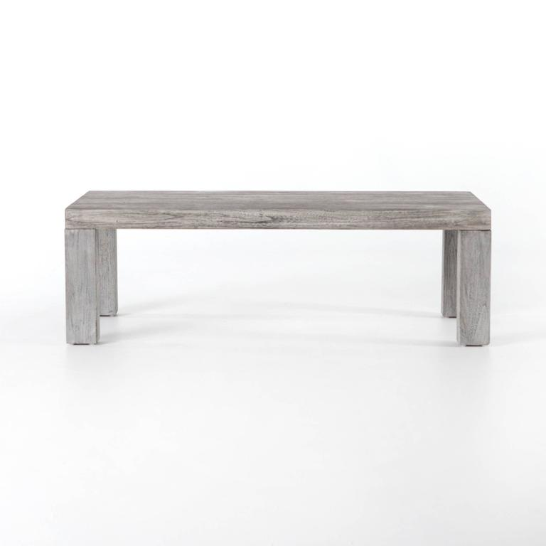 "Modern coffee table, teakwood is fashioned into a clean-lined coffee table and weathered to a natural grey. Indoor, outdoor. Dimensions: W 48""; H 15.5""; D 26""."