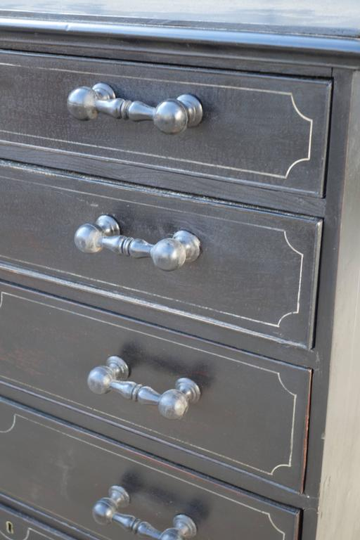 English dresser in Ebony paint finish, with faux moulding detail, and unusual handles.