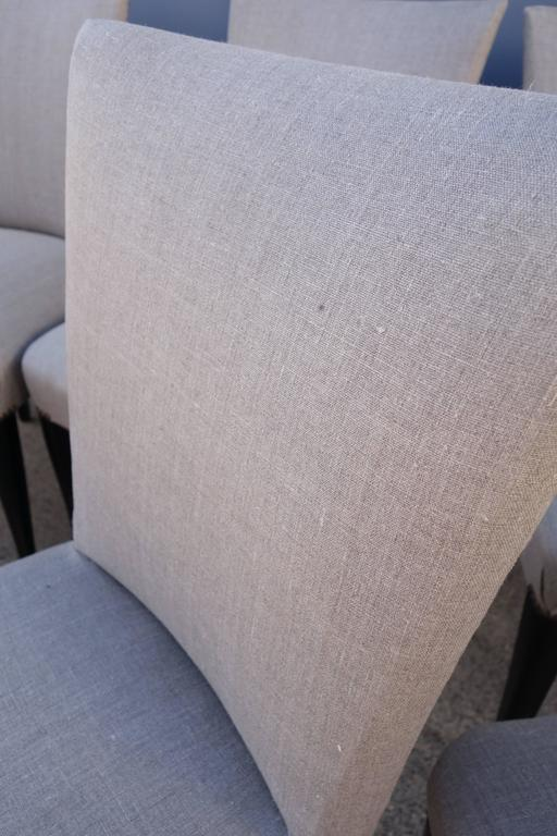Set of eight 1940s French dining chairs, newly upholstered in grey linen with nailheads to back.