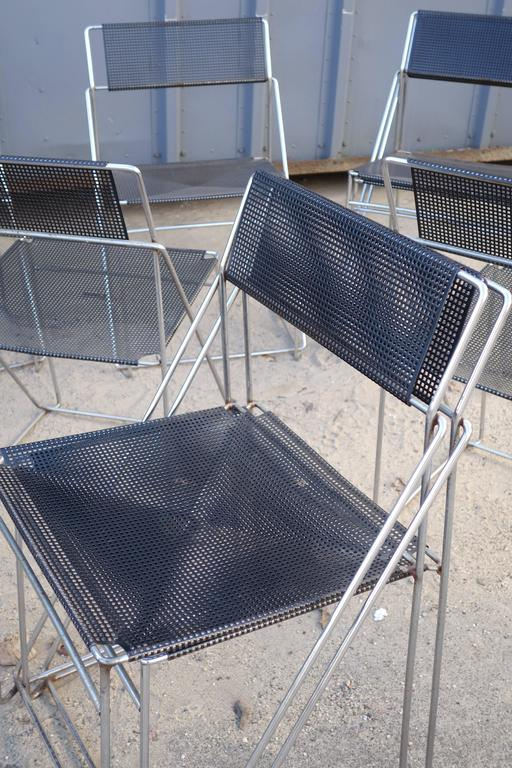 Set of ten Dutch dining chairs with pierced metal seats and backs in black, circa 1950.