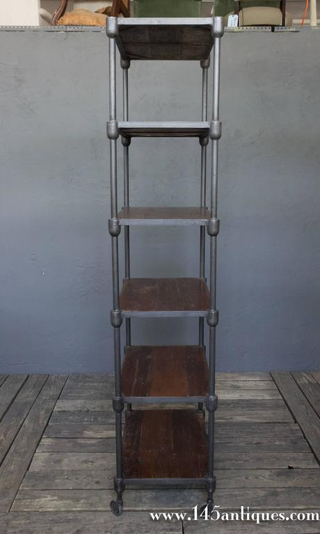Tall Wood And Metal Industrial Shelving Unit On Casters At