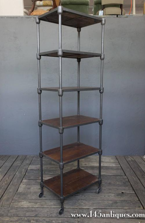 Tall Wood And Metal Industrial Shelving Unit On Casters