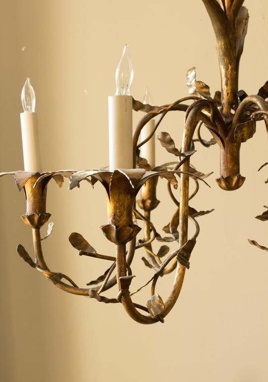 Six-armed Spanish gilt metal chandelier with floral motif. UL wiring is available.