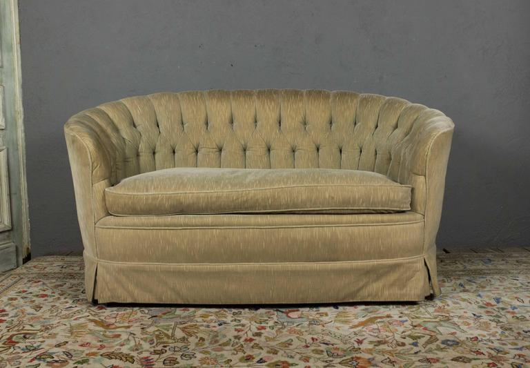 A comfortable tufted back settee with a single large seat cushion, original upholstery. American made, circa 1960.