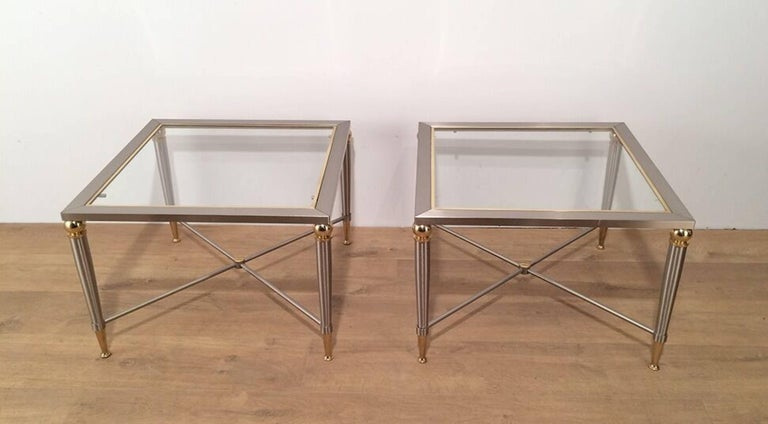 Pair of side tables with a brushed steel finish. French, circa 1970.  These tables are currently in France. Please allow us 4 to 6 weeks for delivery. Price includes delivery to our warehouse in Long Island City, NY 11101.