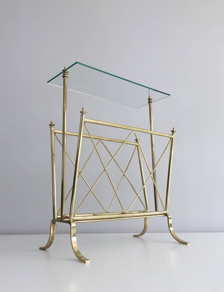 1940s French brass and glass magazine rack attributed to Maison Jansen.   This piece is currently in France, please allow 4 to 6 weeks for delivery. Shipping to our warehouse in Long Island City, New York is included in the price.