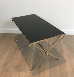 Brass and Back Glass Coffee Table with X Stretcher attributed to Maison Jansen