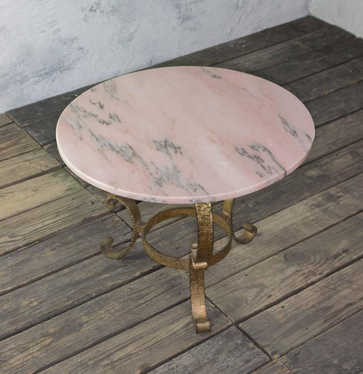 Small Round Coffee Table With Gold Gilt Base And Pink Marble Top.