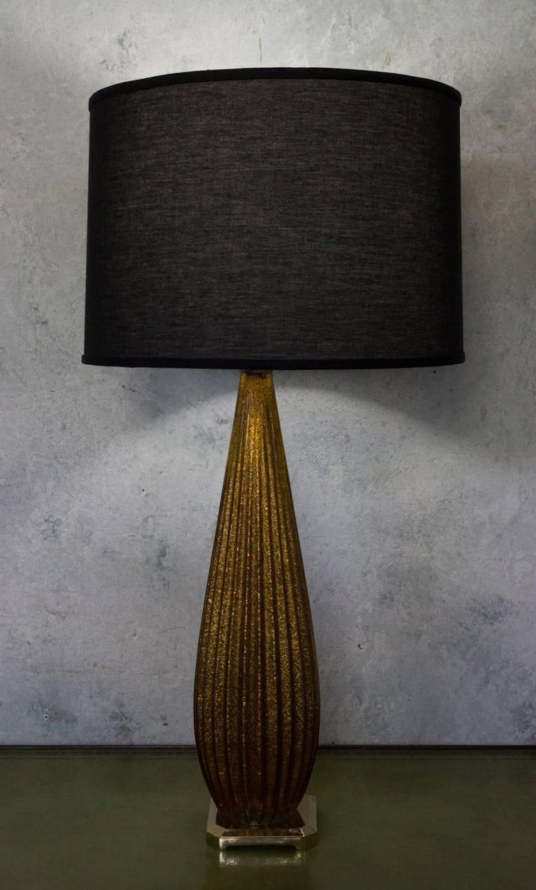 Tall Murano glass lamp with gold flecks inside the glass. Not sold with shade. circa 1960s.