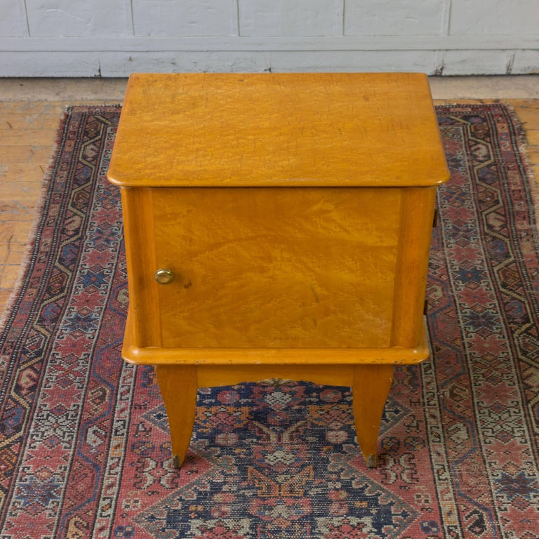 A pair of French 1940's bird's-eye maple nightstands.  These nightstands have an interior drawer and period hardware.  the interior is maple veneered.
