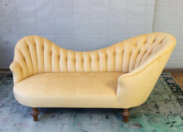 Newly restored and upholstered tufted settee. The frame is original with replacement horsehair filled seat and upholstered in a light gold velvet.