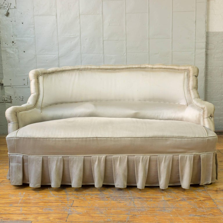 French 19th century settee upholstered in silvery grey satin.