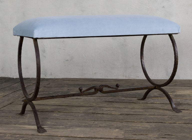 Beautiful wrought iron bench with a circular motif legs and a detailed stretcher.