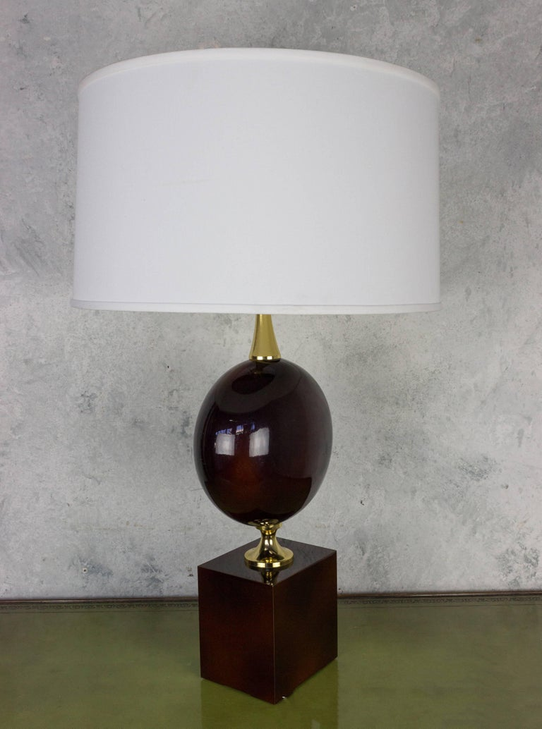 French table lamp made by Maison Barbier, circa 1970s.  The lamp has two main parts, one elliptical and the other rectangular, in eggplant colored enameled brass, the two parts being separated with a brass spacer support. There are some minor