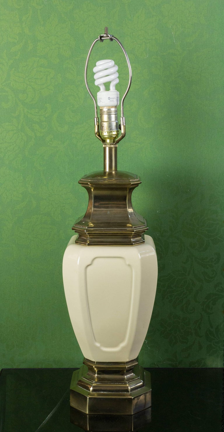 American Mid-Century Modern white ceramic and brass table lamp with an oriental theme.