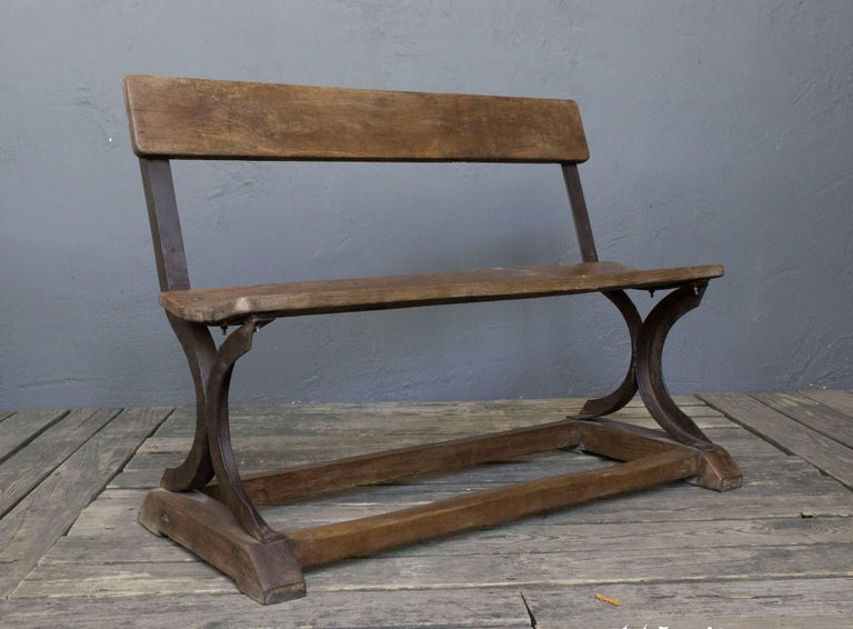 Very unusual small scaled bench with a beautiful aged patina. May have originally been used in a factory. Four of these benches are available.