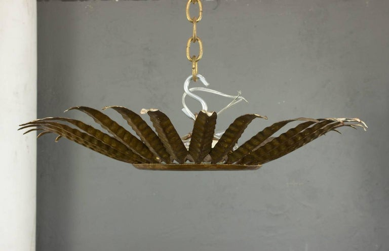 Spanish Gilt Metal Sunburst Ceiling Fixture with Leaf Decoration In Good Condition For Sale In Long Island City, NY