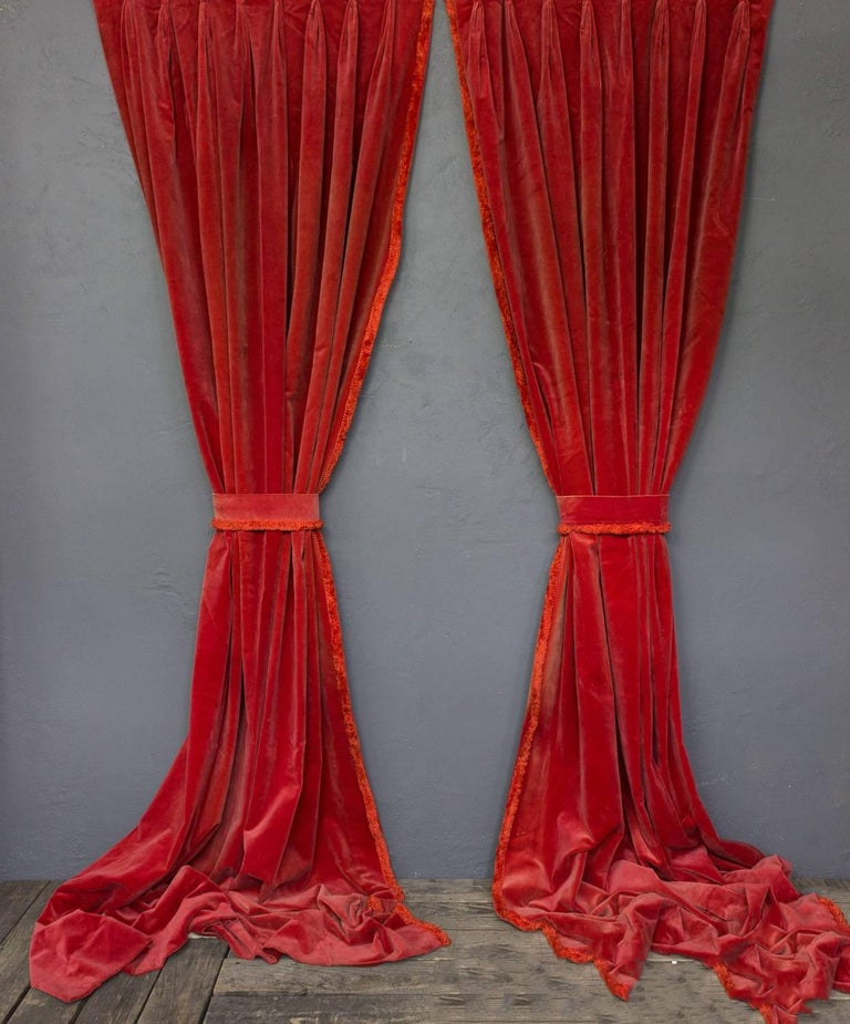 """Two pairs of stunning red velvet draperies. Each panel is 35"""" wide for a total width of the pair is 70"""" wide."""