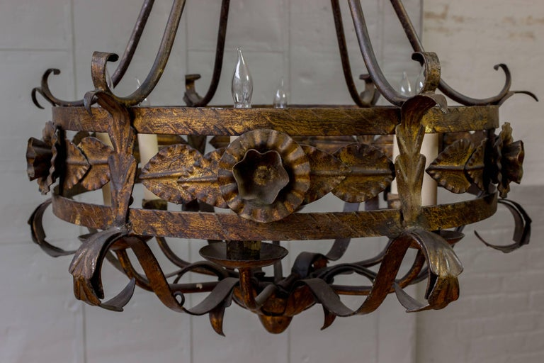 Mid-20th Century Spanish Gilt Iron Chandelier with Leaf and Floral Decorations For Sale