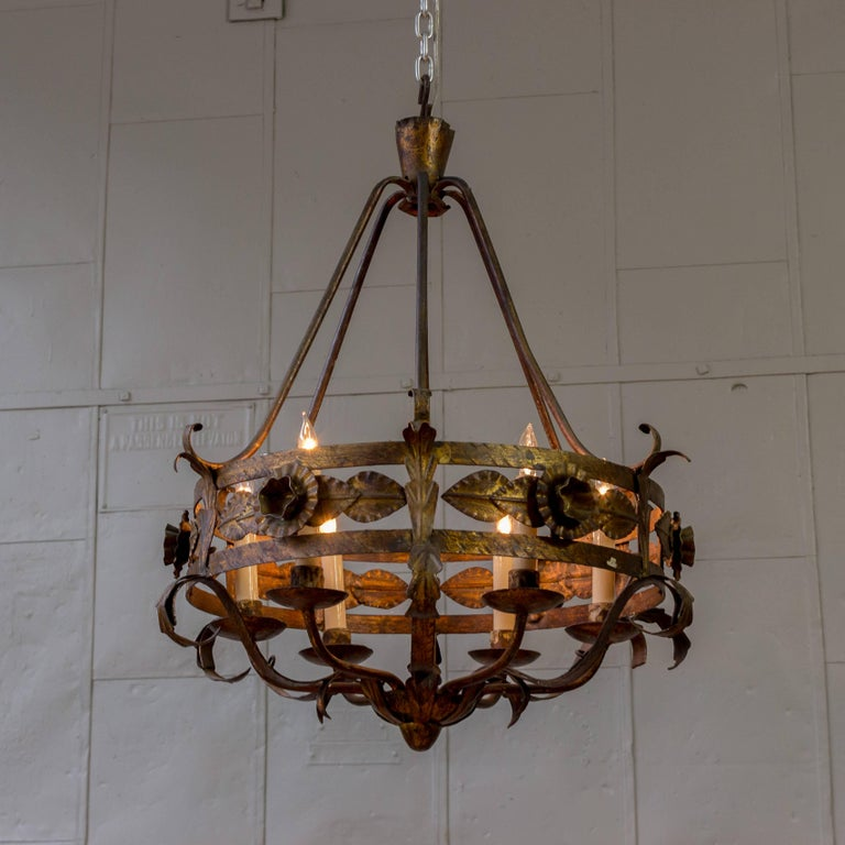 Spanish gilt iron chandelier with leaf and floral decorations.